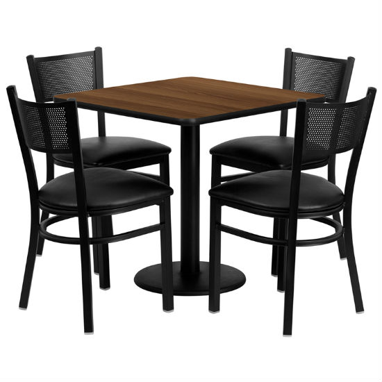 #84 - 30'' SQUARE WALNUT LAMINATE TABLE SET WITH 4 GRID BACK METAL CHAIRS - BLACK VINYL SEAT